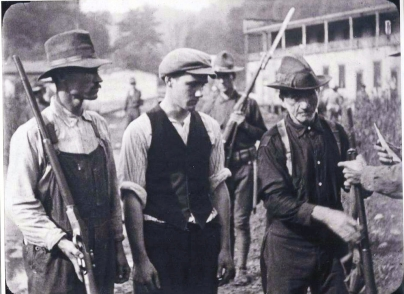 miners from battle of blair mt at the foot of blair mt giving up their guns
